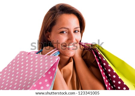 Portrait of a beautiful woman holding shopping bags against white background - stock photo