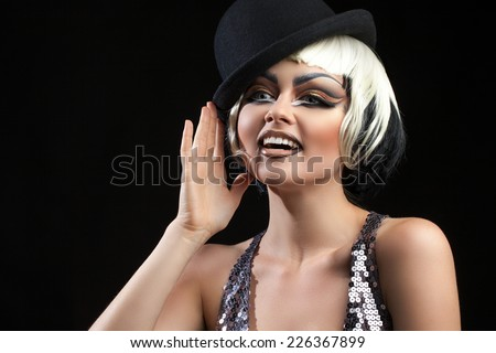 portrait of a beautiful woman in a black hat and bright makeup - stock photo