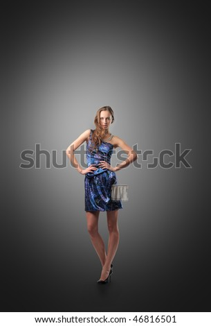 Portrait of a beautiful woman in a blue dress - stock photo