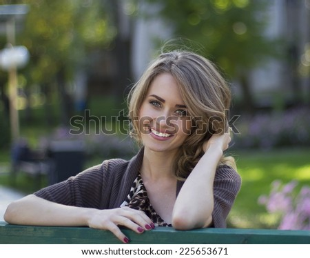 Portrait of a beautiful woman in autumn - stock photo