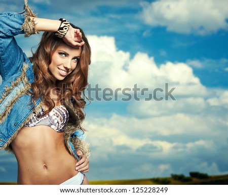 Portrait of a beautiful woman in bikini - stock photo