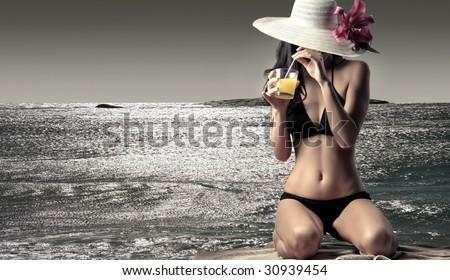 Portrait of a beautiful woman in bikini on the beach - stock photo