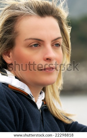 Portrait of a beautiful woman in casual clothing looking away - stock photo