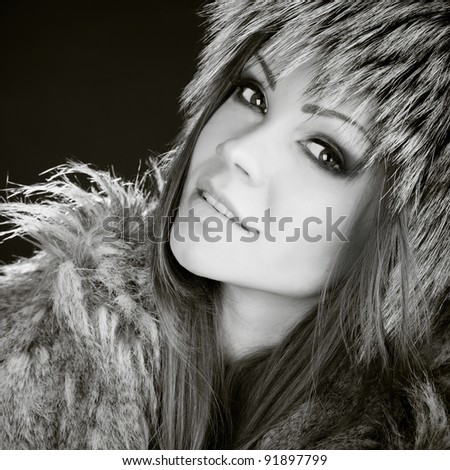 portrait of a beautiful woman in furs black and white - stock photo