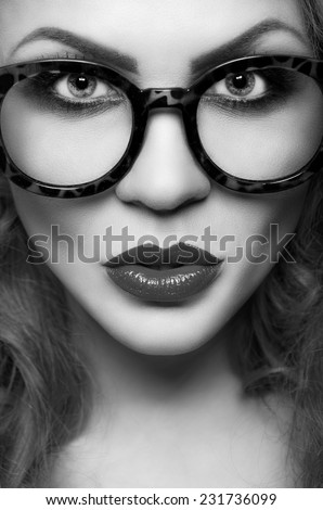 Portrait of a beautiful woman in glasses close up - stock photo