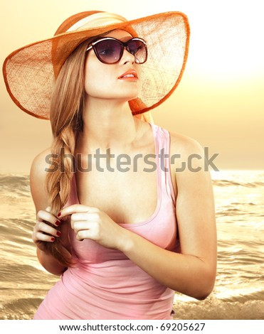 Portrait of a beautiful woman in glasses  on the beach - stock photo