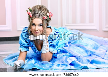 Portrait of a beautiful woman in medieval era dress. - stock photo
