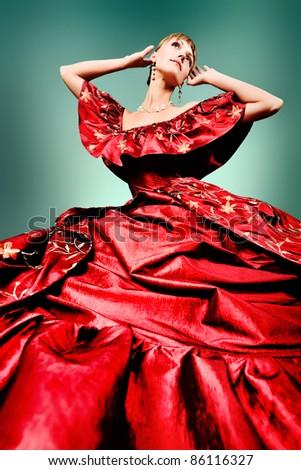 Portrait of a beautiful woman in medieval era dress. Shot in a studio. - stock photo