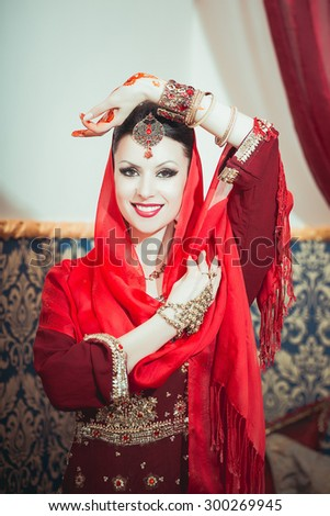 Portrait of a beautiful woman in oriental dress. Grace and beauty. Indian apparel