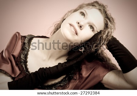 Portrait of a beautiful woman in retro style - stock photo