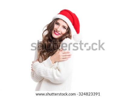 Portrait of a beautiful woman in santa hat with long curly hair, isolated. - stock photo