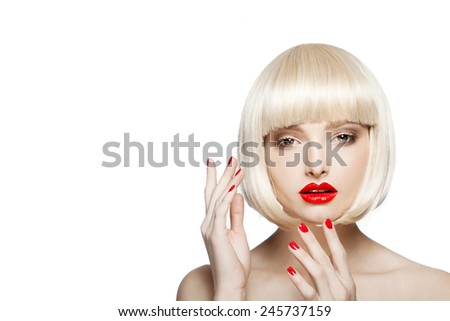 portrait of a beautiful woman in short blond bob wig with bright make-up, red lips,red nails,pretty young girl - stock photo