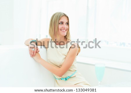 portrait of a beautiful woman in the cafe. resting and relaxing, urban lifestyle - stock photo