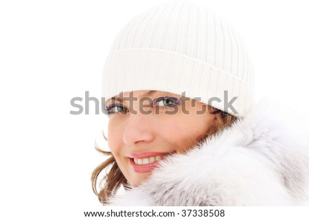 Portrait of a beautiful woman in the fur coat