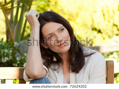 Portrait of a beautiful woman in the garden - stock photo