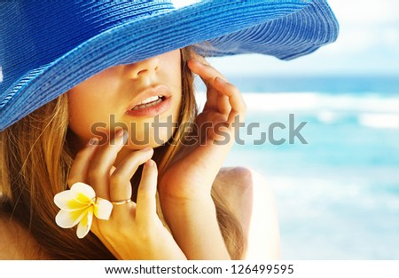 Portrait of a beautiful woman in the hat - stock photo