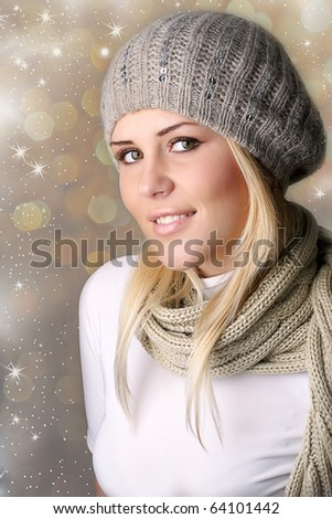 Portrait of a beautiful woman in the hat and scalf - stock photo