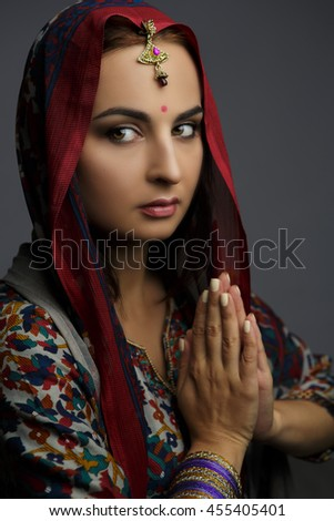Portrait of a beautiful woman in traditional clothes of India - stock photo