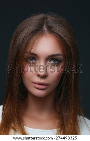 Portrait of a beautiful woman , isolated on black background - stock photo