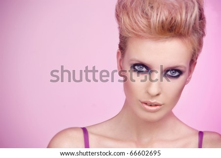 Portrait of a beautiful woman isolated on pink background - stock photo