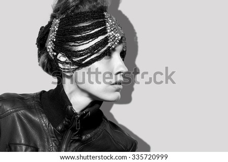 Portrait of a beautiful woman. Jewelry, leather jacket. black and white