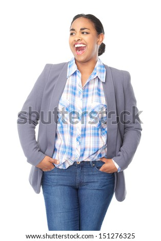 Portrait of a beautiful woman laughing with hands in pocket - stock photo