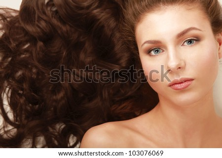 Portrait of a beautiful woman lying on the floor with a towel - stock photo