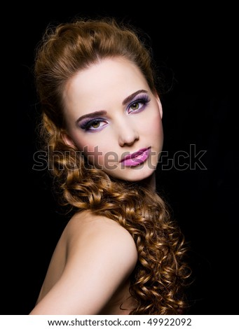 Portrait of a beautiful  woman on a black background - stock photo