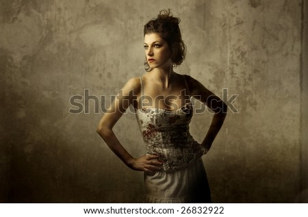 portrait of a beautiful woman on a grey wall