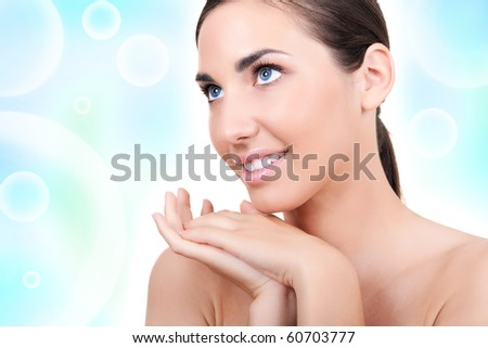 portrait of a beautiful woman on blue background