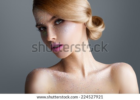 Portrait of a beautiful woman on gray background