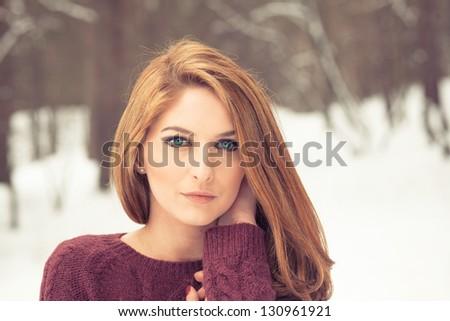 Portrait of a beautiful woman on winter park - stock photo