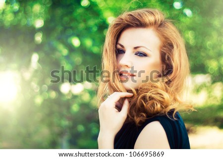 Portrait of a beautiful woman outdoors - stock photo