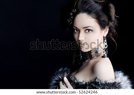 Portrait of a beautiful woman over black background.. - stock photo
