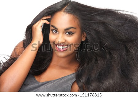 Portrait of a beautiful woman smiling with flowing hair isolated on white - stock photo