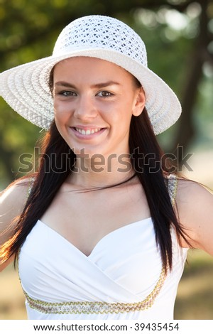Portrait of a beautiful woman standing in woods