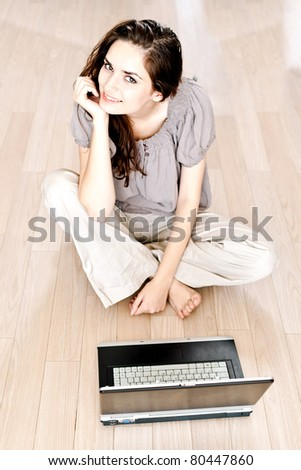 portrait of a beautiful woman using a laptop - casual still life - stock photo