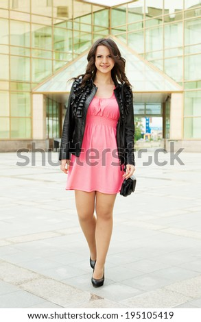 Portrait of a beautiful  woman walking outdoor