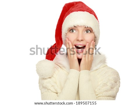 Portrait of a beautiful woman wearing a santa hat smiling , isolated on white background