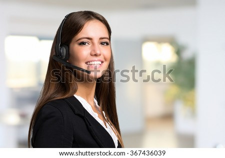 Portrait of a beautiful woman wearing an headset - stock photo