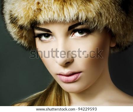 portrait of a beautiful woman wearing fur - stock photo