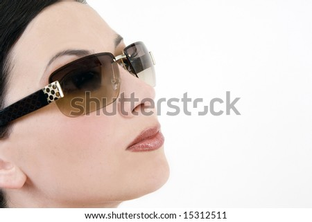 Portrait of a beautiful woman wearing sunglasses - stock photo