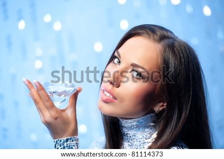Portrait of a beautiful woman with a diamond - stock photo