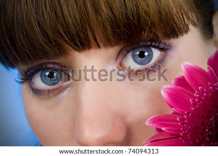 Portrait of a beautiful woman with a flower