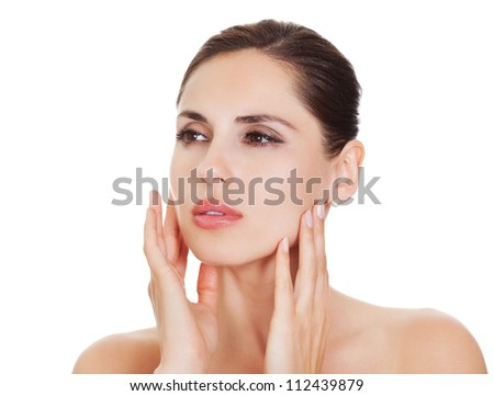 Portrait of a beautiful woman with a natural flawless complexion and her hands to her cheeks. Isolated on white - stock photo