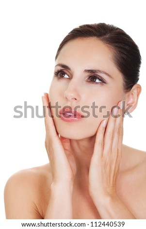 Portrait of a beautiful woman with a natural flawless complexion and her hands to her cheeks. Isolated on white