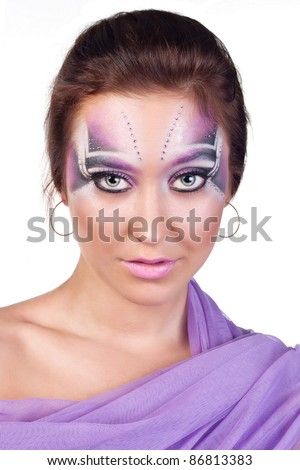 Portrait of a beautiful woman with an exotic makeup - stock photo