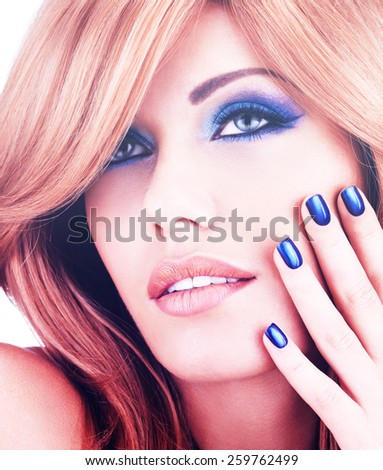 portrait of a beautiful woman with blue nails, blue makeup and  long red hairs  on white  background - stock photo