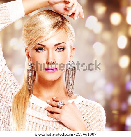 Portrait of a beautiful woman with bright pink lips and  fashion makeup. Model posing at studio on the art background - stock photo