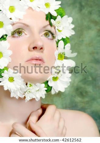 Portrait of a beautiful woman with camomiles - stock photo